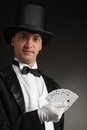 Magician with card Royalty Free Stock Images