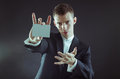 Magician with cards showing the for pose Stock Photography