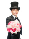 Magician with flower bouquet magic performance circus show concept Royalty Free Stock Images