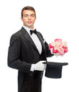 Magician with flower bouquet magic performance circus show concept taking out of top hat Royalty Free Stock Image