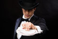 Magician in hat showing trick with playing cards Royalty Free Stock Photo