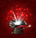Magician hat, wand and magical glow Royalty Free Stock Photo