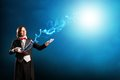 Magician holding a cylinder where the magic fly Royalty Free Stock Image