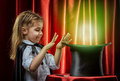 Magician the little does tricks Stock Photography