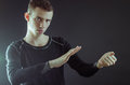 Magician looking at hands for pose Royalty Free Stock Images