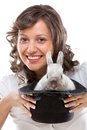 Magician with rabbit in magic hat on white background Stock Images