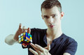 Magician with rubic cube showing the for pose Royalty Free Stock Images