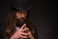 Magician serious long haired thinking about hypnosis man with moustache having gimlet eyes Royalty Free Stock Photos