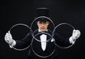 Magician showing trick with linking rings magic performance circus show concept in top hat Stock Photos