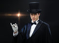 Magician in top hat with magic wand showing trick performance circus show concept Stock Image