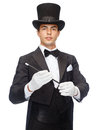 Magician in top hat with magic wand showing trick performance circus show concept Royalty Free Stock Image