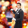 Magician in top hat with magic wand showing trick performance circus show concept Stock Images