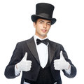 Magician in top hat showing thumbs up magic performance circus show concept Royalty Free Stock Photo