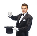 Magician in top hat showing trick magic performance circus show concept with imaginary rabbit Stock Image