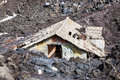 Magma house engulfed by lava natural disaster a flooded and destroyed Stock Photo