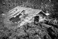 Magma house engulfed by lava natural disaster a flooded and destroyed black and white Stock Images