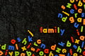 Magnetic letters on black with the word FAMILY Royalty Free Stock Photo