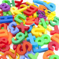 Magnetic letters and numbers Royalty Free Stock Photo