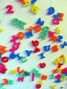 Magnetized letters and numbers on refrigerator Royalty Free Stock Photo