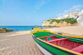Magnificent beach on the coast of portugal at villa carvoeiro fishing boat in foreground Royalty Free Stock Photos