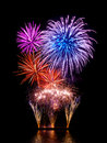 Magnificent fireworks display with happy colors on black background reflected on water Royalty Free Stock Photos