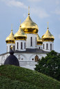 Magnificent golden domes of assumption cathedral in dmitrov the beautiful the dmitrov's kremlin hidden behind the earthen Stock Image