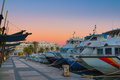 Magnificent magenta sunset color in marina harbor.  End of a warm sunny day in Ibiza, St Antoni de Portmany, Spain. Royalty Free Stock Photo