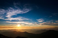 Magnificent sunset sky over silhouette of the mountains Royalty Free Stock Photo