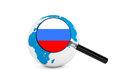 Magnified flag of russia with earth globe on a white background Stock Image