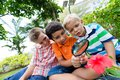 Magnifier boys looking at the flower with the Royalty Free Stock Image