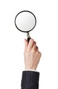 Magnifier glass in woman hand isolated on white background Royalty Free Stock Photos