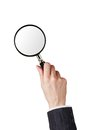 Magnifier glass in woman hand isolated on white background Royalty Free Stock Image