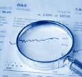 Magnifier laying on financial statement Royalty Free Stock Photography
