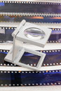 Magnifier loupe over transparency film slide for editerial department Royalty Free Stock Images