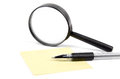 Magnifier,pen and notepaper Stock Image