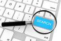 Magnifier with Search key Royalty Free Stock Photo