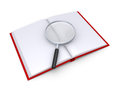 A magnifier is on top of an opened book d magnifying glass over Royalty Free Stock Photography