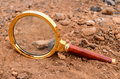 Magnify glass abandoned on the desert rock Royalty Free Stock Photo