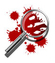 A magnifying glass being used to inspect the bloody evidence of a crime scene Stock Photo