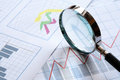 Magnifying Glass And Chart Stock Photography