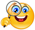 Magnifying glass emoticon Royalty Free Stock Image