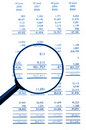Magnifying Glass On Financial Balance Sheet Royalty Free Stock Photo