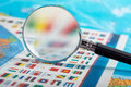 Magnifying glass on the flags closeup of of countries Royalty Free Stock Photography