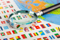 Magnifying glass on the flags closeup of of countries Royalty Free Stock Photos
