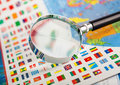 Magnifying glass on the flags closeup of of countries Stock Photo