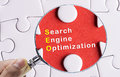 Magnifying glass focusing on seo Stock Images