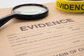 magnifying glass with forensic tool for crime scene investigation Royalty Free Stock Photo