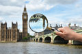 Magnifying glass in the hand Royalty Free Stock Photo