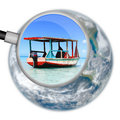 Magnifying glass holiday vacation looking for the perfect in this conceptual image for the travel industry Royalty Free Stock Photo