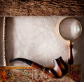 Magnifying glass on old parchment Stock Photo